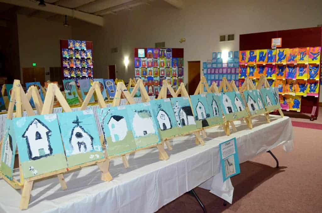 Various student artwork of churches
